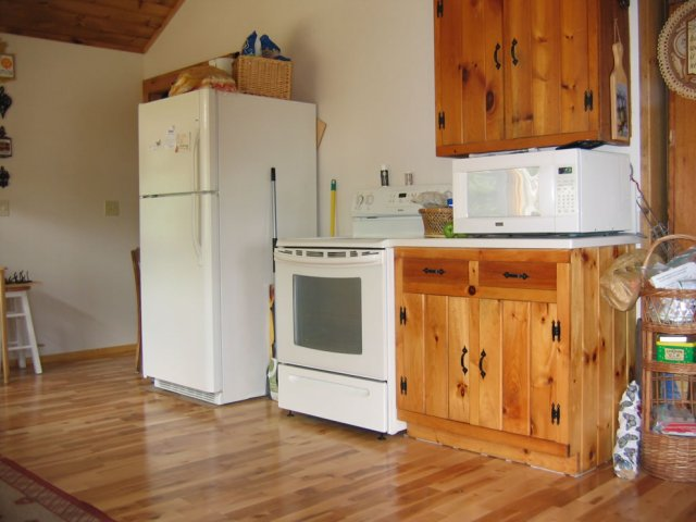 Kitchen right of Lake Ninevah Vermont rental. BIG fridge, giant microwave. Programmable stove.